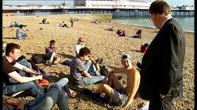 voters reaction england east sussex brighton ext people sitting on beach people on beach with pier in backgroundpeople people paddle boarding in sea... - deck chair stock videos & royalty-free footage