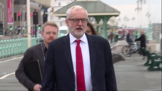 deep divisions over brexit england brighton ext jeremy corbyn mp along promenade with andrew fisher seumas milne and unidentified woman - seumas milne stock videos & royalty-free footage