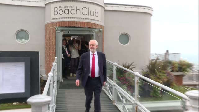 labour party conference 2019: deep divisions over brexit; england: brighton: ext various shots of jeremy corbyn mp along from brighton beach club... - jeremy corbyn stock videos & royalty-free footage