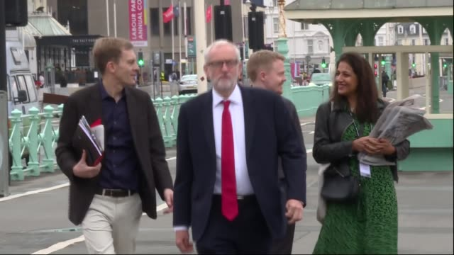 jeremy corbyn brighton beach club arrival and departure england east sussex brighton ext jeremy corbyn mp from car and along promenade towards with... - seumas milne stock videos & royalty-free footage