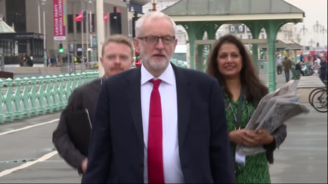 senior aide andrew fisher to resign england east sussex brighton ext jeremy corbyn mp along brighton seafront and arriving at 'brighton beach club'... - itv weekend lunchtime news点の映像素材/bロール