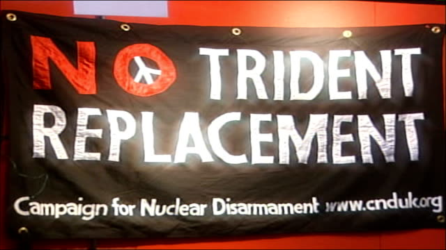 conference gvs gmex centre int people sitting at tables and chairs in exhibition area of conference centre / campaign for nuclear disarmament stand... - replacement stock videos & royalty-free footage