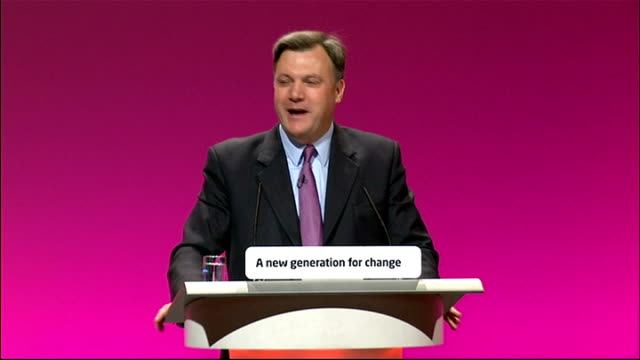 ed balls speech england manchester photography** ed balls at podium with councillor elaine costigan / delegates applauding / balls applauding at... - politics and government stock videos & royalty-free footage