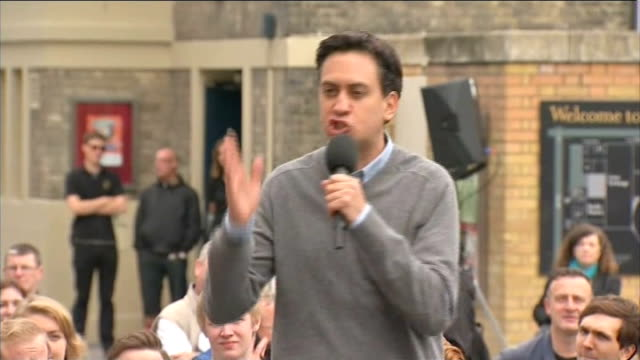 Ed Miliband pledges to tackle the cost of living crisis Ed Miliband shaking hands with supporters Ed Miliband standing on raised platform Ed Miliband...