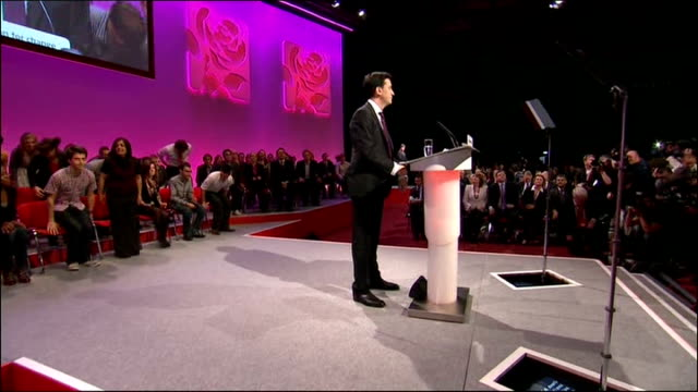 ed miliband's first speech as new labour leader england manchester photography*** ed miliband mp walks into labour party conference and waves from... - ed miliband stock-videos und b-roll-filmmaterial