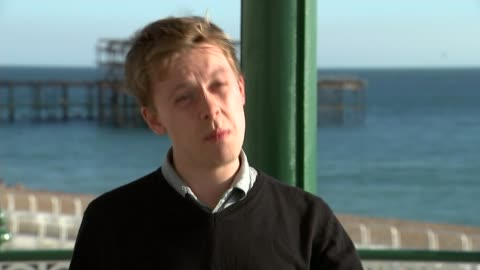 labour party conference: jeremy corbyn speech: reaction; england: east sussex: brighton: ext brighton bandstand on seafront reporter and guests on... - フィル・コリンズ点の映像素材/bロール