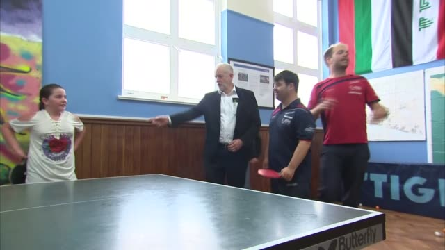 Jeremy Corbyn visits table tennis club ENGLAND West Sussex Brighton INT Jeremy Corbyn MP arriving at table tennis club and chatting with people /...