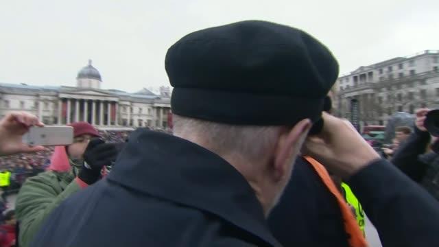 john mcdonnell speech / trident row r27021607 / london trafalgar square ext jeremy corbyn mp arriving through crowd and press scrum back view corbyn... - trident stock videos & royalty-free footage