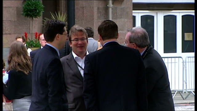 ruth kelly resignation ext geoff hoon mp leaving hotel with suitcase tony mcnulty mp standing chatting with other delegates jim knight mp watching... - tony mcnulty stock videos & royalty-free footage