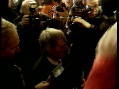 donation; lib ext formula 1 boss bernie ecclestone along as surrounded by press - bernie ecclestone stock videos & royalty-free footage