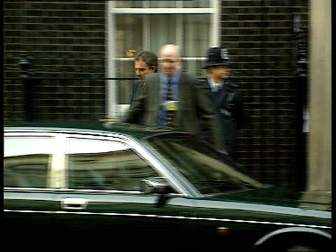 funding row itn england london downing st tony blair mp from no 10 and into car car away pan - tony blair stock-videos und b-roll-filmmaterial