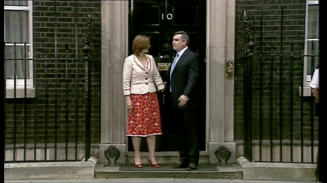 Electoral Commission refer case to the police LIB Downing Street EXT Brown and Sarah on doorstep of Number 10