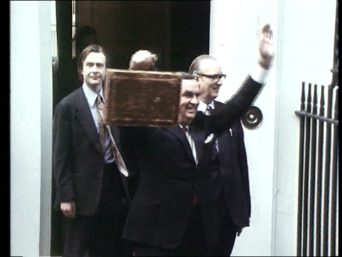 handling of the economy lib downing street healy standing on doorstep of number 11 with battered budget briefcase in hand sussex brighton centre gv... - john prescott politiker stock-videos und b-roll-filmmaterial