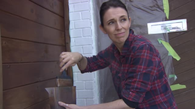 Labour Party leader Jacinda Ardern painting fence at her home with partner Clarke Gayford on polling day of 2017 General Election election and...