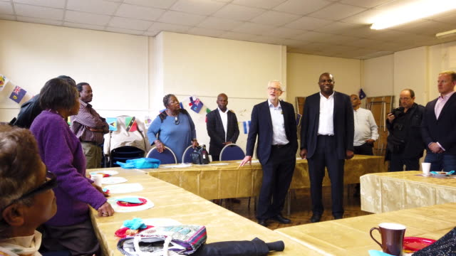 labour party leader jeremy corbyn and david lammy mp introduce themselves to guests at the cardinal heenen centre on june 20 2019 in ilford england... - jeremy corbyn stock videos and b-roll footage