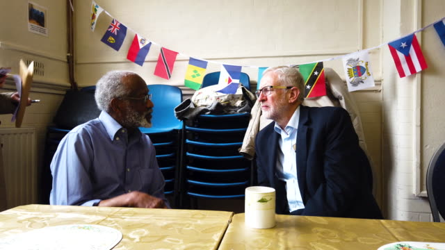 labour party leader jeremy corbyn talks with alvin griffith who came from barbados on october 31 at the cardinal heenen centre on june 20 2019 in... - jeremy corbyn stock videos and b-roll footage