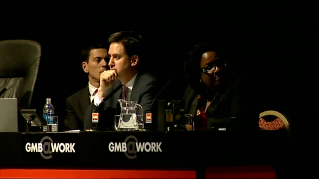 diane abbott scrapes into race merseyside southport int david miliband ed miliband and diane abbott on stage at the 2010 gmb conference general view... - イングランド サウスポート点の映像素材/bロール