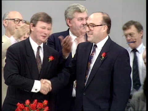 stockvideo's en b-roll-footage met leadership election 2200 england london royal horticultural hall cms outgoing labour ldr neil kinnock mp on platform at special conference with wife... - peter mandelson