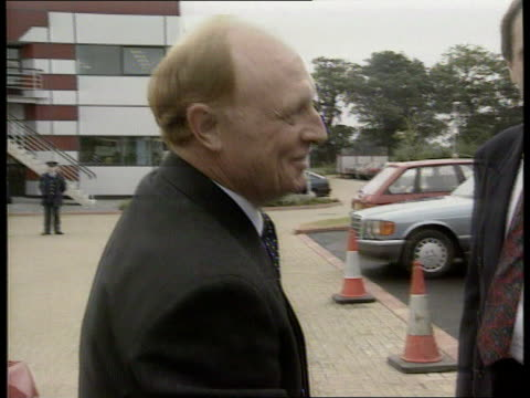 labour party leadership election speculation england birmingham ms dark red car draws up towards and neil kinnock gets out zoom in as shakes hands... - 不公平点の映像素材/bロール