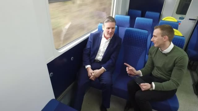 stockvideo's en b-roll-footage met labour party leadership: interview with sir keir starmer; england: ext gv sir keir starmer mp along platform with suitcase gv train along to platform... - itv