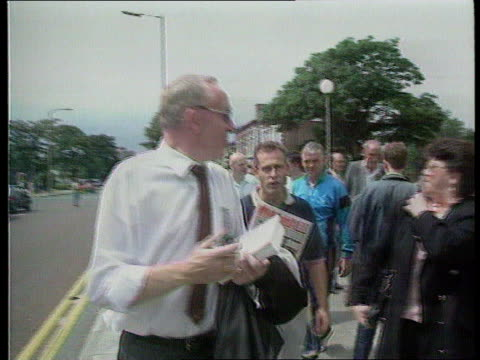 militant purge/terry fields ext / sunny / hot england cms terry fields being intvwd liverpool court cms fields along towards chatting man holding... - merseyside stock videos and b-roll footage