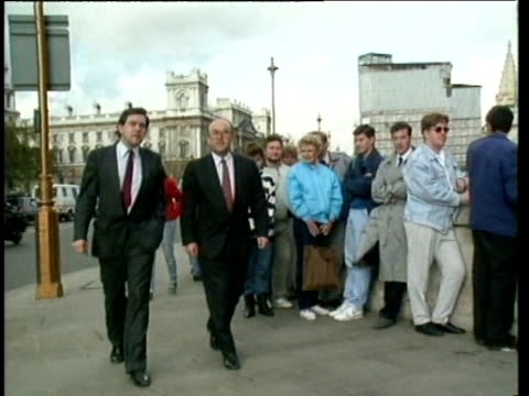 labour party mps john smith and gordon brown walk towards houses of parliament 27 oct 89 - ゴードン ブラウン点の映像素材/bロール