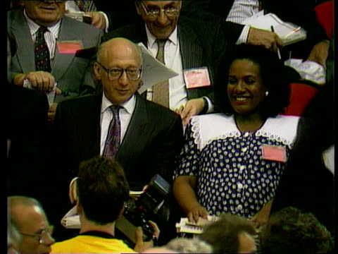 and labour left; int tgv side conference labour mps tony benn and denis skinner sitting on top platform chatting gerald kaufman sitting beside diane... - gerald kaufman stock videos & royalty-free footage