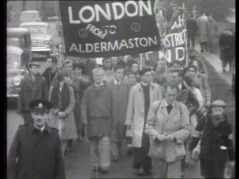 labour party nuclear policy reactions f'back cnd marchers along michael foot along with marchers in aldermaston itn lib f'back bruce kent cutting... - aldermaston stock videos & royalty-free footage