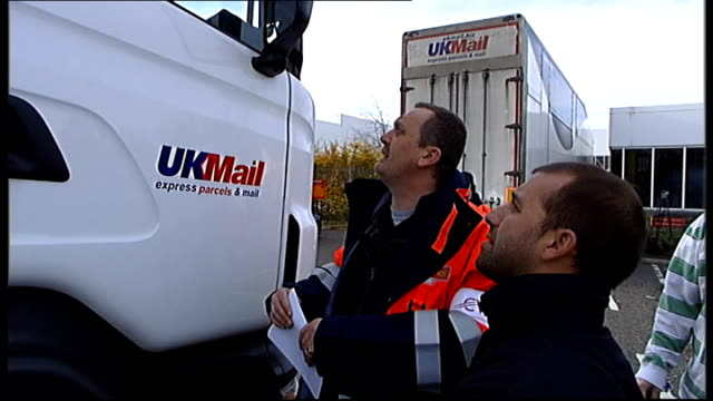 Labour Party's links with the Communication Workers' Union SCOTLAND Edinburgh Striking Scottish postal worker talking with unseen driver of UKMail...