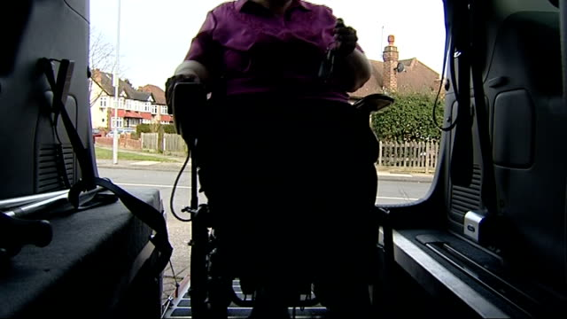 labour plan welfare changes based on previous payment of tax south london ext jane young into specially adapted vehicle in her wheelchair and gettign... - 社会福祉点の映像素材/bロール