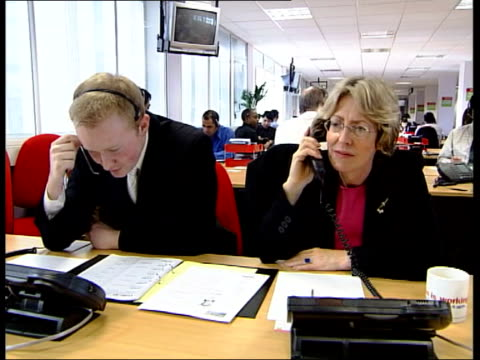 labour politicians 'cold call' voters in election build up england gateshead charles clarke mp on telephone 'cold calling' voters clarke on telephone... - dialling stock videos & royalty-free footage