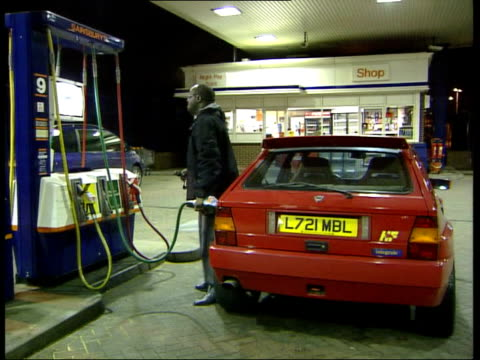 labour promise tax cut on unleaded petrol itn london man filling car with petrol - unleaded stock videos and b-roll footage