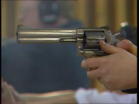 labour promises total ban on handguns itn lib sesq guns fired in target shooting range - handgun stock videos & royalty-free footage