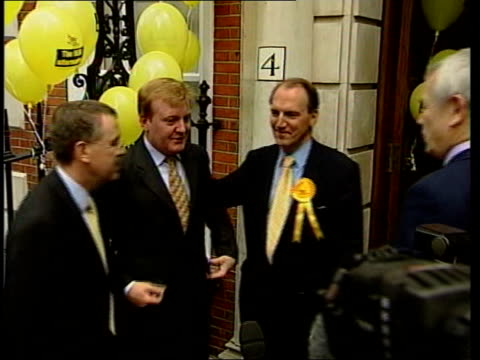labour win roundup of results and events liberal democrat headquarters charles kennedy mp and another towards kennedy greeting simon hughes mp and... - cherie charles stock videos & royalty-free footage