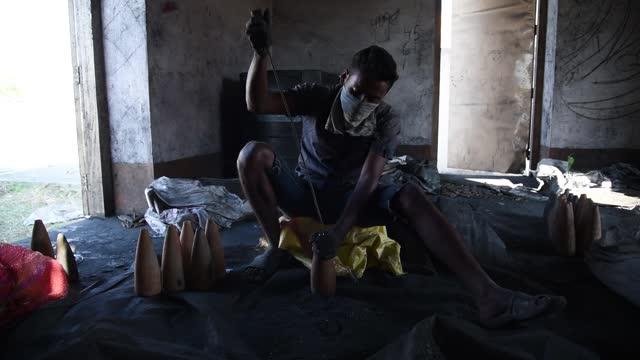 labourer working with gunpowder mixture inside a firecracker factory ahead of diwali festival in barpeta of assam on 3 november 2018. firework of... - gunpowder explosive material stock videos & royalty-free footage