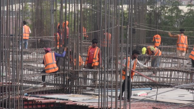 labourers work on a high rise building construction site in dhaka - brick stock videos & royalty-free footage