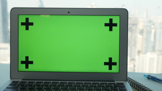 DS: Labtop green screen chroma key with business office background
