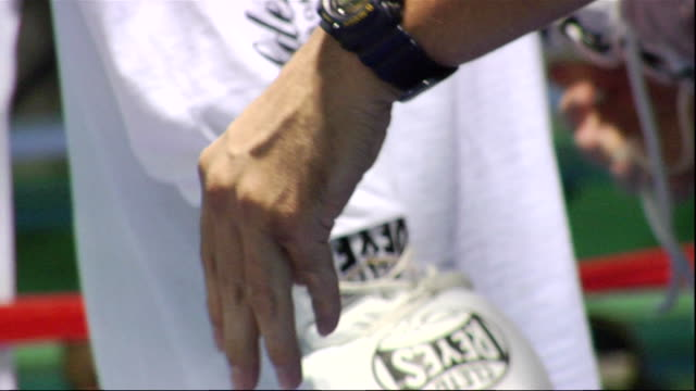 cu laces of white reyes boxing gloves being untied by man's hands - untied stock videos and b-roll footage