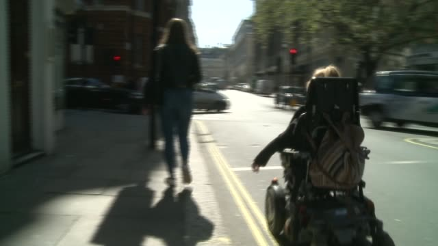 lack of step-free access at tube stations can dramatically extend journeys; england: london: ext lauren along street past bond streetunderground... - pavement stock videos & royalty-free footage
