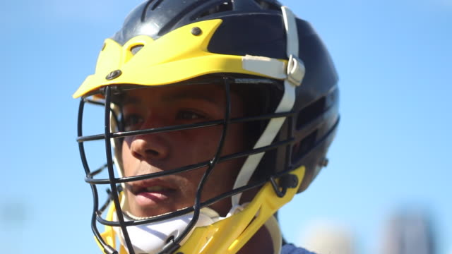 lacrosse player putting on helmet. - sports glove stock videos and b-roll footage