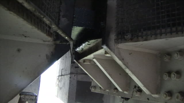 a ladder is positioned under a dripping piece of machinery. - bolt stock videos & royalty-free footage