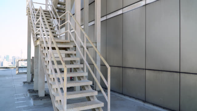 ladder on the top of the building - steps and staircases stock videos & royalty-free footage