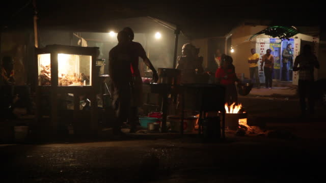 ws ladies cooking fish over flames nigeria is home to nearly 200 million people which has earned it the name giant of africa it is an oil rich... - jos nigeria stock videos & royalty-free footage