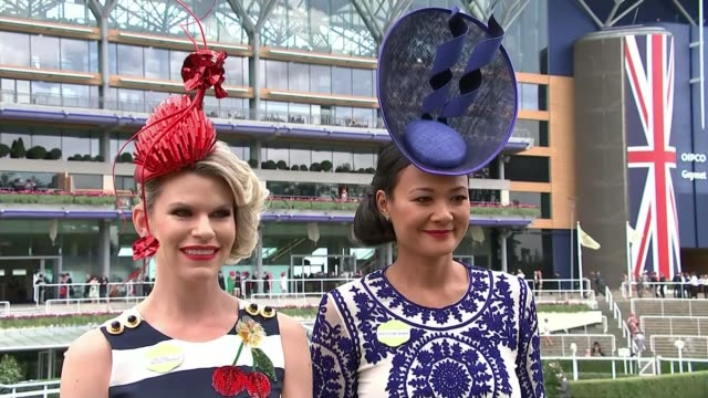 'Ladies' Day' at Royal Ascot ENGLAND Berkshire Ascot Racecourse EXT Men playing musical instruments SOT Woman wearing elaborate pink hat and outfit...