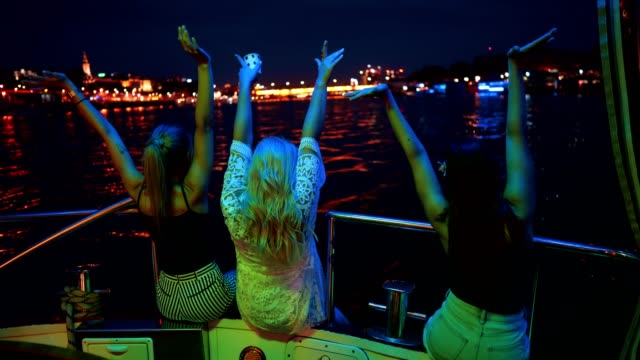 Ladies enjoying on the boat at night