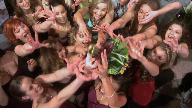 oh ladies reach up to grab thrown bouquet - blumenbouqet stock-videos und b-roll-filmmaterial