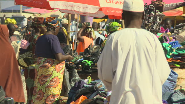 ladies selling shoes at market nigeria is home to nearly 200 million people which has earned it the name giant of africa it is an oil rich country... - jos nigeria stock videos & royalty-free footage