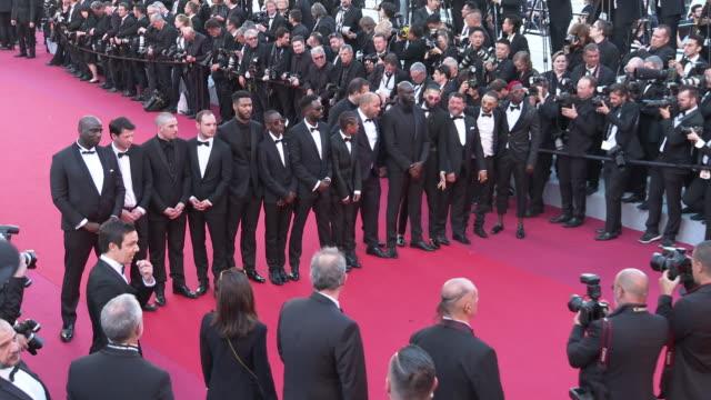 vídeos de stock, filmes e b-roll de ladj ly, damien bonnard, alexis manenti, djebril didier zonga and other cast at 'les miserables' red carpet arrivals - the 72nd cannes film festival... - cannes