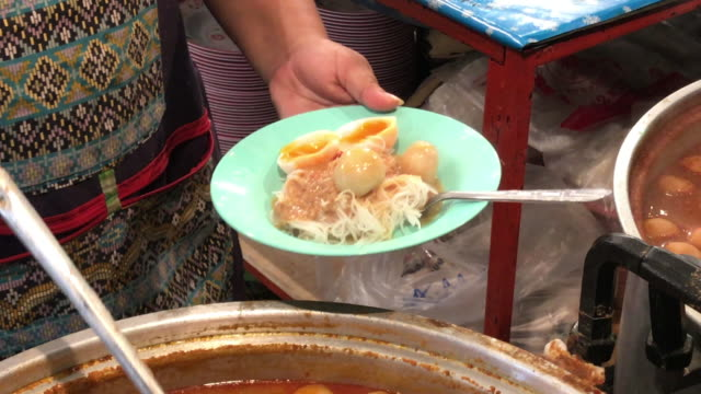 ladle fish meatball curry for serving ,bangkok , thailand. - ladle stock videos & royalty-free footage
