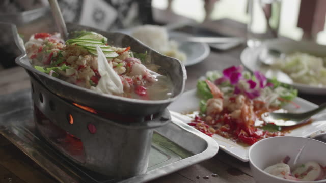 ladling spicy seafood soup, traditional thai food - reality tv stock videos and b-roll footage